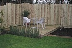Sculptured fence with softwood deck